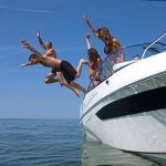 People jumping off boat image